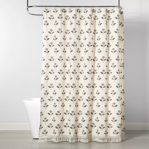 neutral boho bathroom shower curtain idea with floral print and  tassel edge