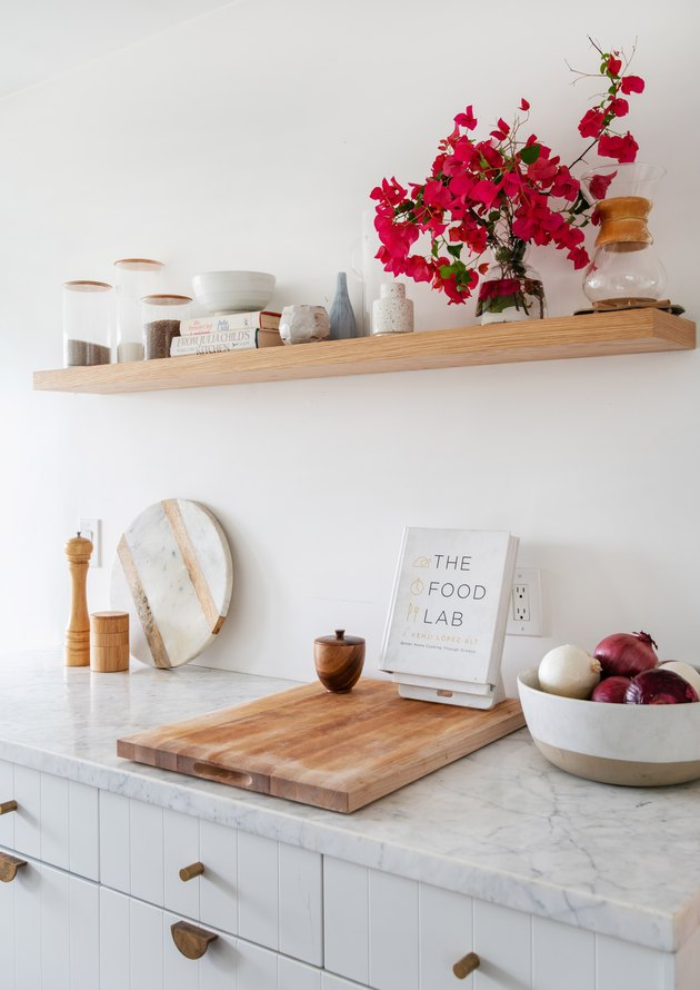 Designlovefest kitchen with white cabinets and open shelving and marble countertops