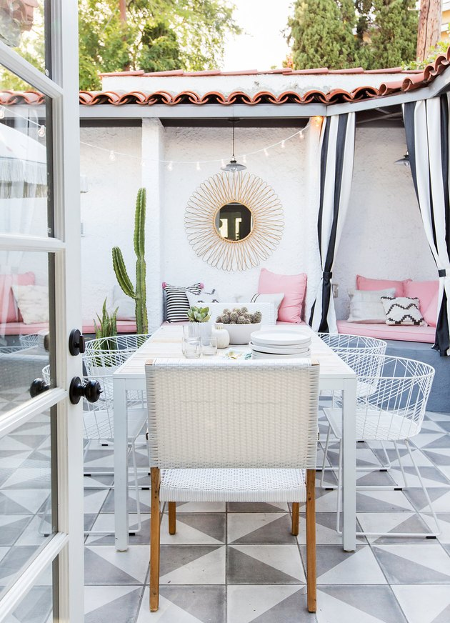 Designlovefest backyard with patterned tile and cozy seating