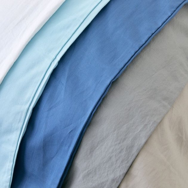 Six sheets in varying shades of blue, gray, and white