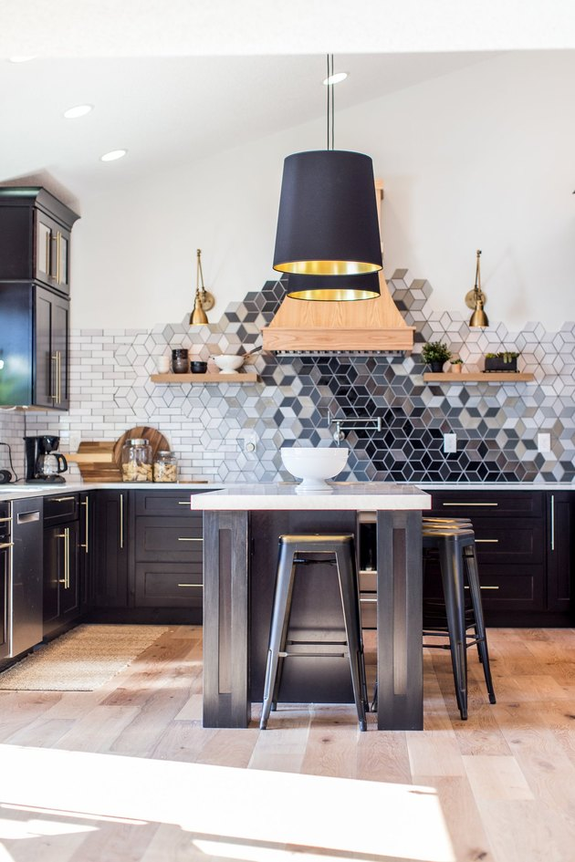 mosaic kitchen backsplash idea with black cabinets and island