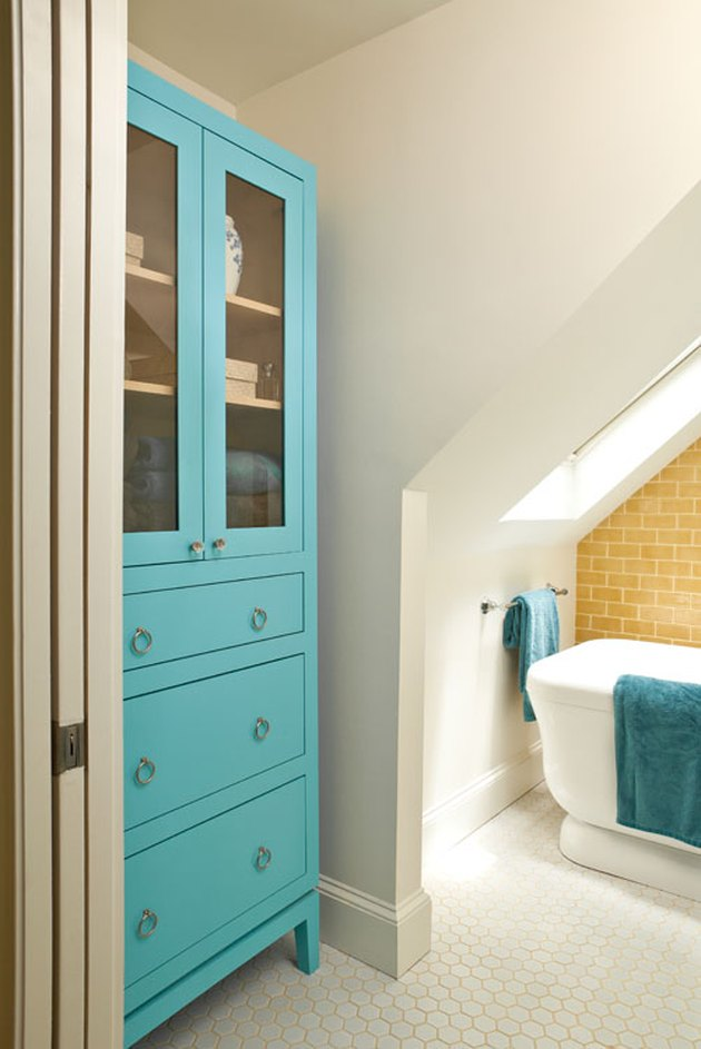 attic bathroom ideas with yellow tile walla and aqua cabinet