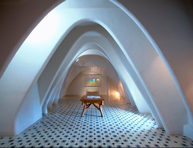 room with arched ceiling and patterned floor