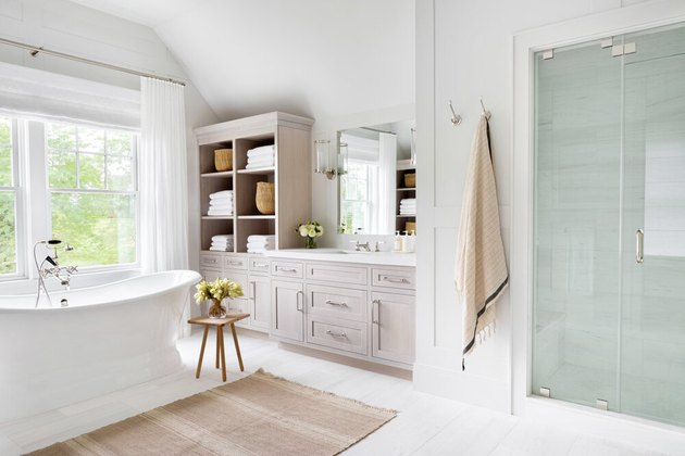 Modern bathroom storage with a freestanding tub, drawers and hutch by Chango & Co.