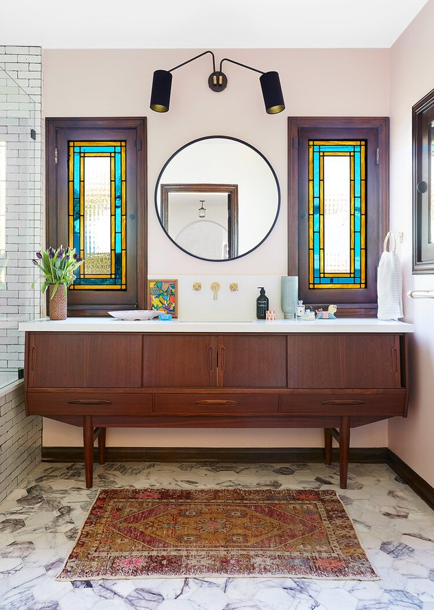art deco stained glass windows in the bathroom above vanity cabinet