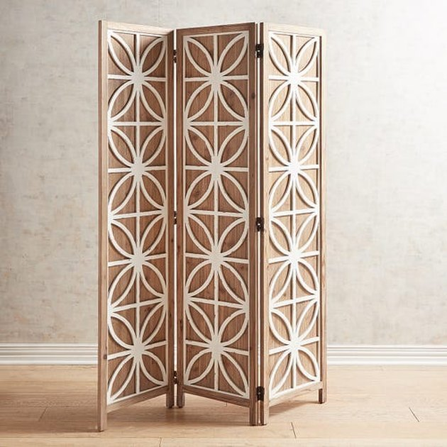 room divider idea for the living room with patterned screen