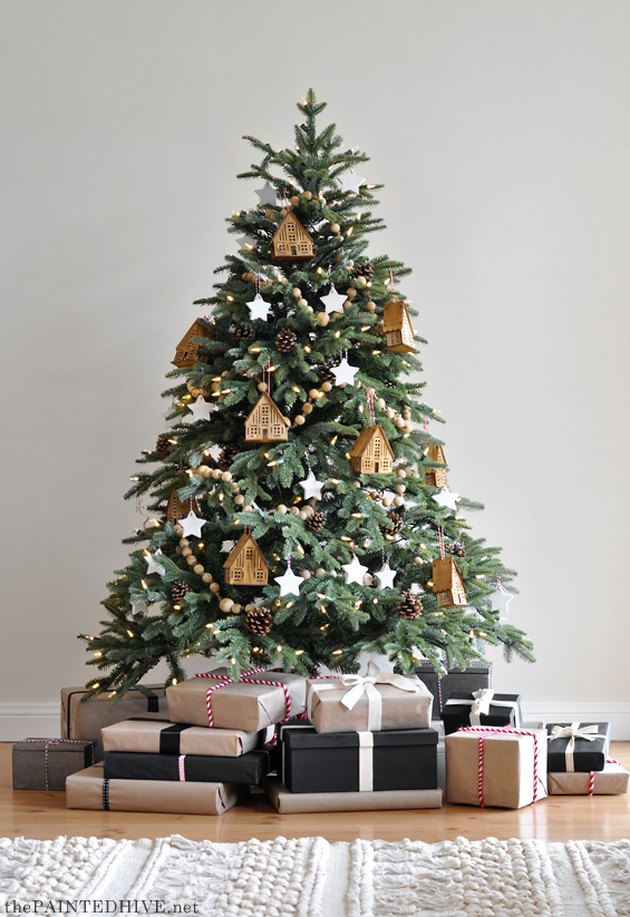 Rustic Christmas tree with wooden house ornaments and wood beaded garland