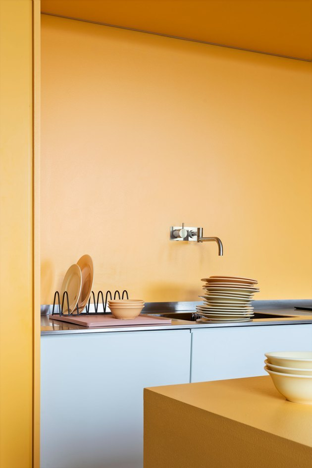 kitchen space with yellow wall