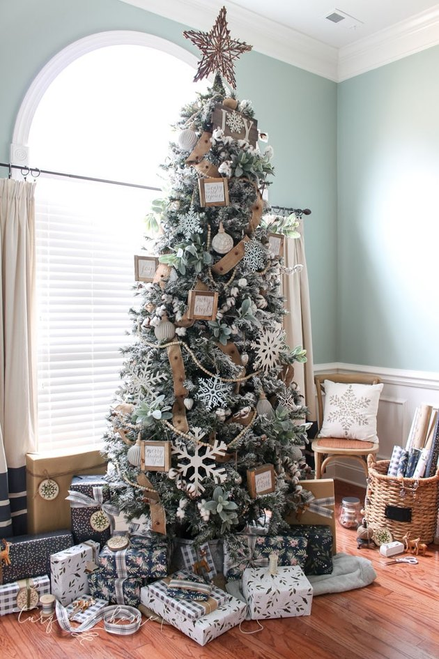 Rustic Christmas tree with DIY wood ornaments and snowflakes