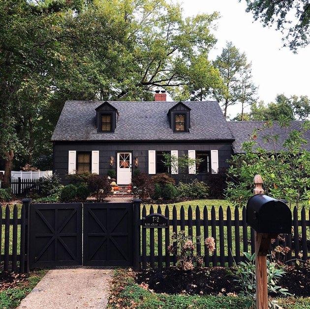Black farmhouse exterior colors showcased on black cottage