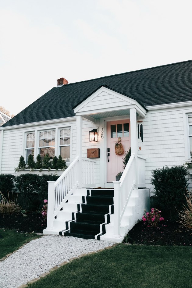 Pink and white farmhouse exterior colors with painted front steps
