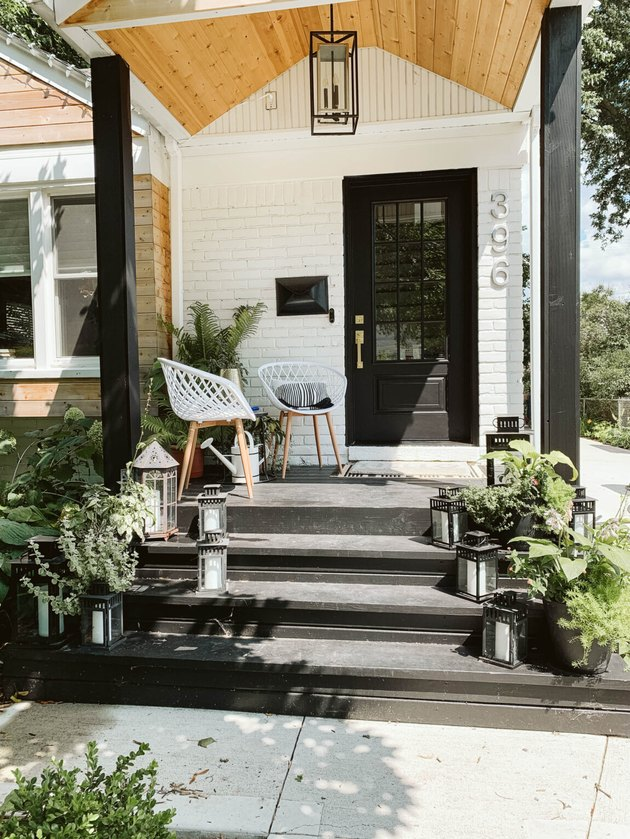black exterior door idea for white house with wood accents