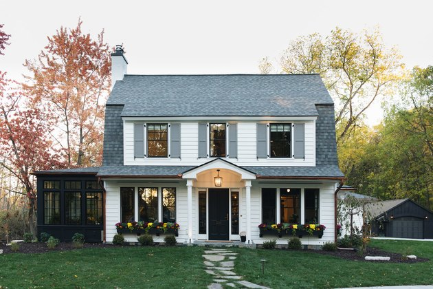 Gray exterior house shutters with white exterior in classic colonial style