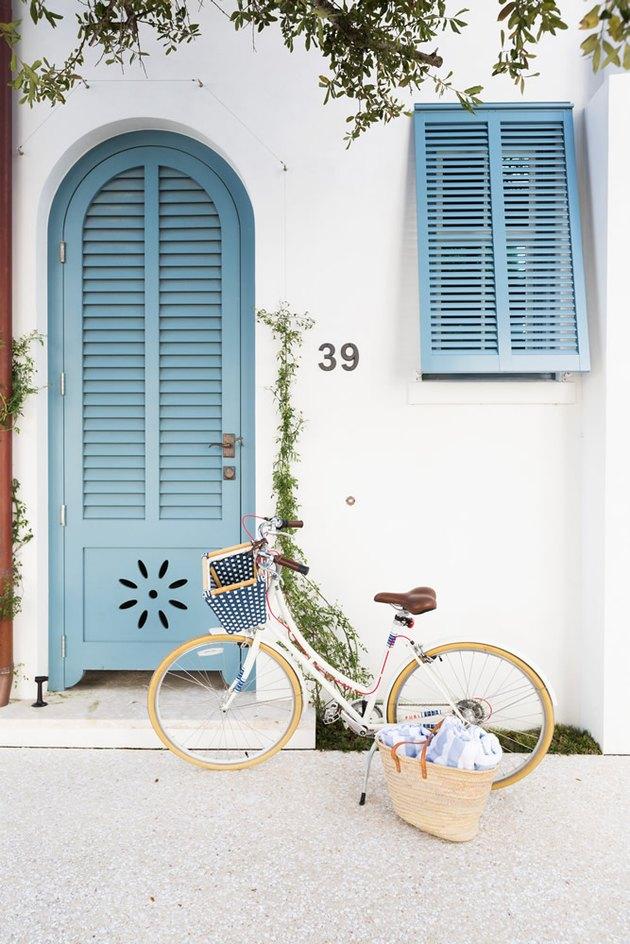 Blue exterior house shutters with shutter-inspired blue door