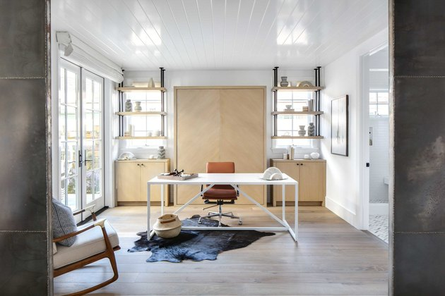 industrial pipe shelving in office with cowhide