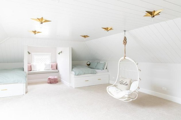 white swing chair in an attic playroom and bedroom