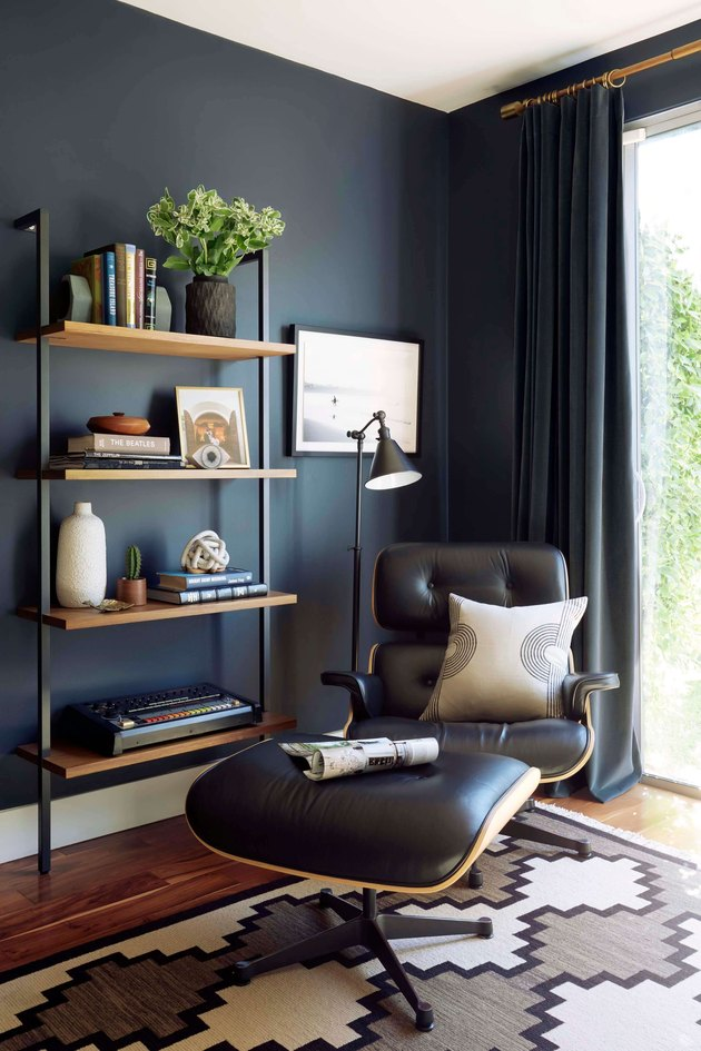 industrial office idea with reading nook and steel-framed shelving
