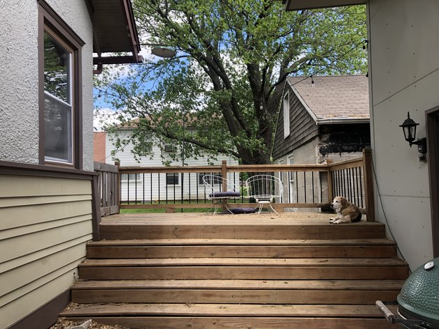 Back deck before and after with a slatted screen fence and wicker furniture