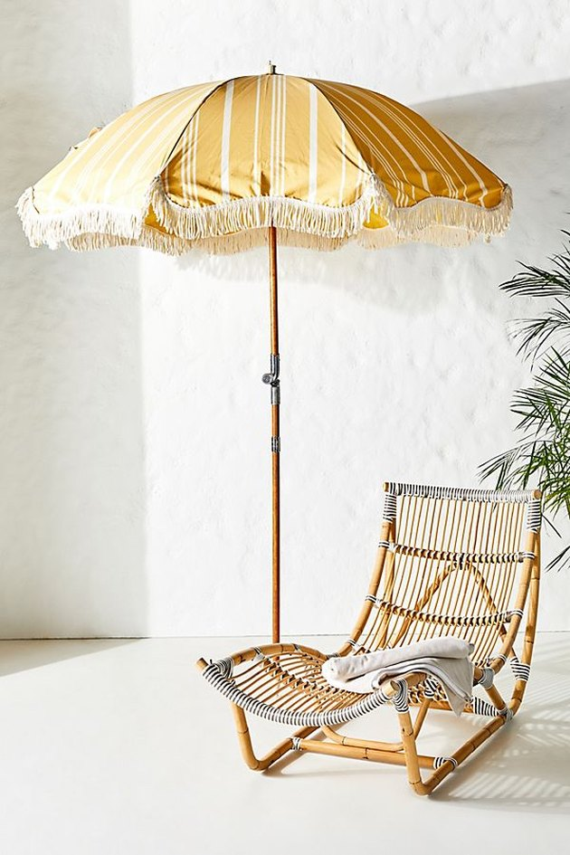 yellow beach umbrella with fringe tassel and stripes