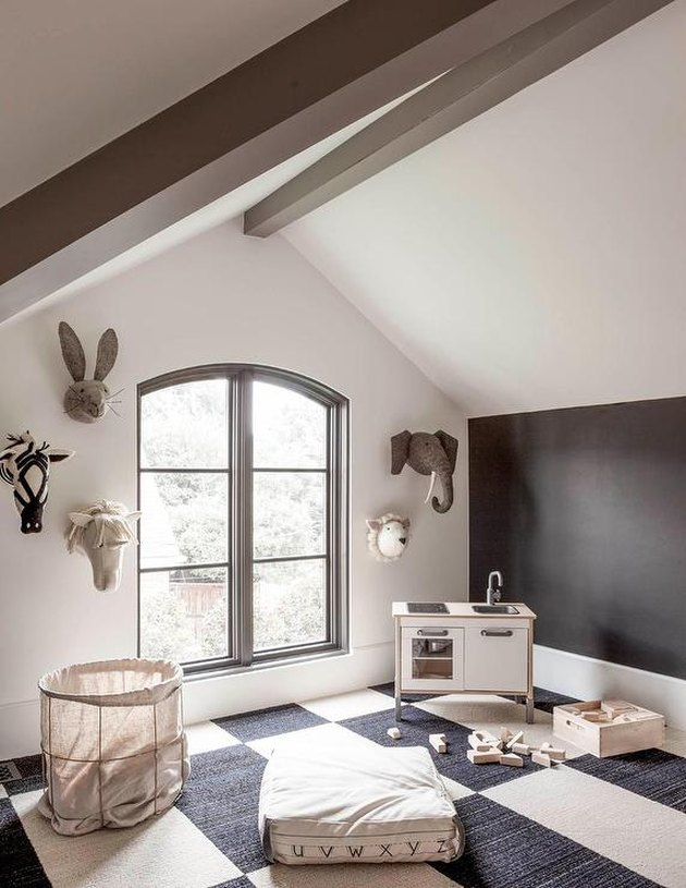 Attic playroom with felt animal heads decor and mini kitchen