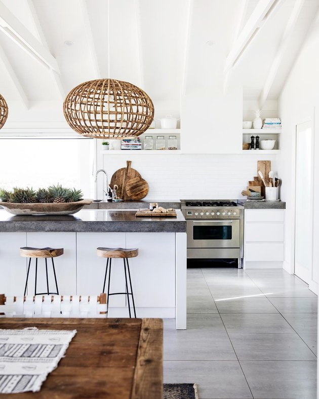Large-scale bohemian kitchen lighting with woven pendant lights hanging above island