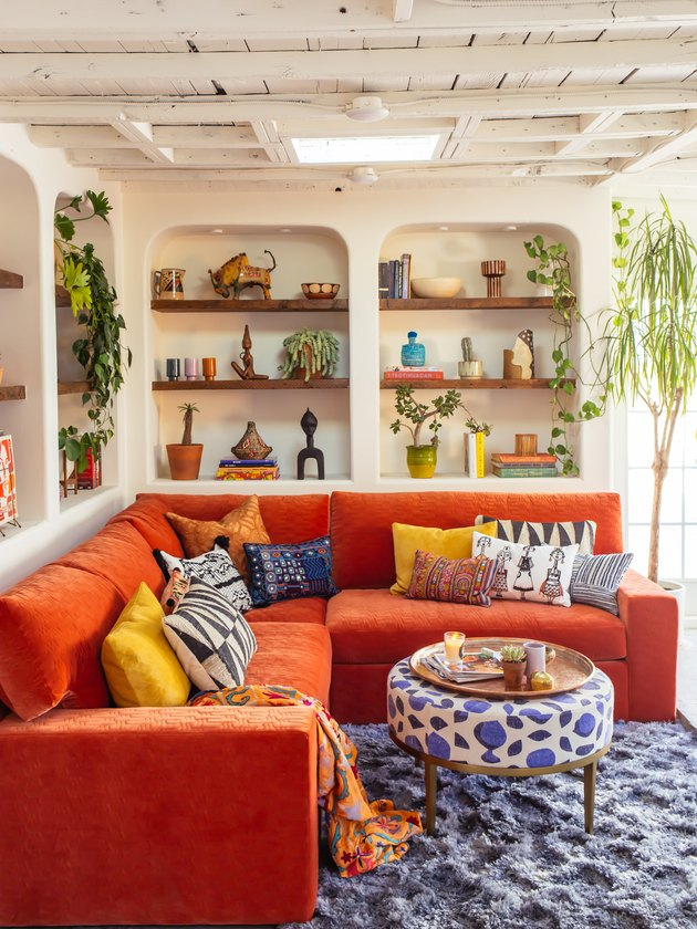 Orange and blue complementary colors in bohemian living room