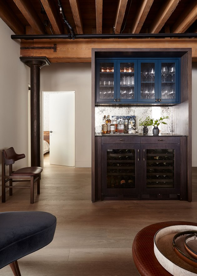 industrial bar idea in basement with blue and wooden cabinets