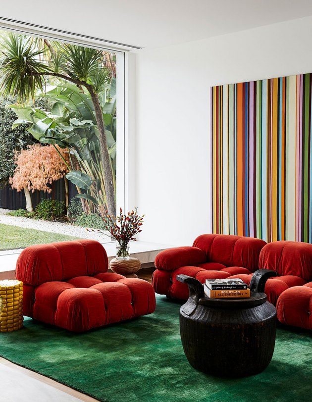 Red and green complementary colors in vintage-inspired living room