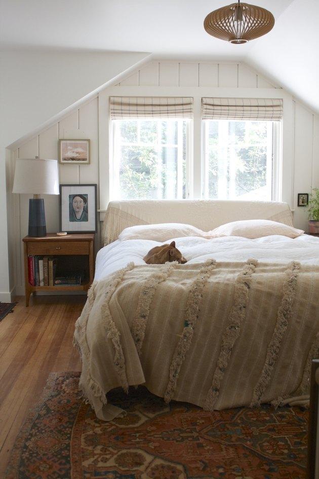 Attic bedroom idea with vintage furniture and framed prints