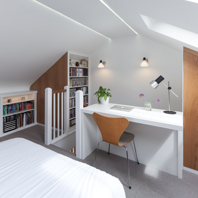 integrated white attic storage with bedroom and office