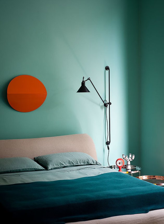 Red and turquoise complementary colors in modern bedroom