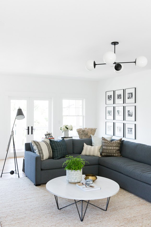 navy blue living room idea with sectional sofa and white walls