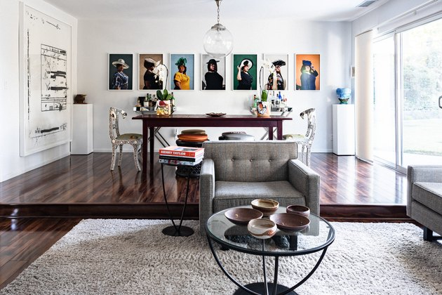 Dining room with art on walls.