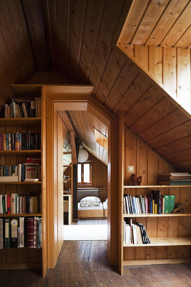 small attic library in rustic home with built-in bookcases