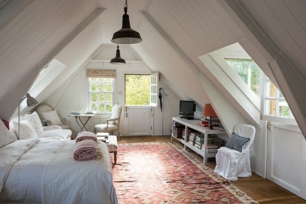 small attic library in bedroom with rug