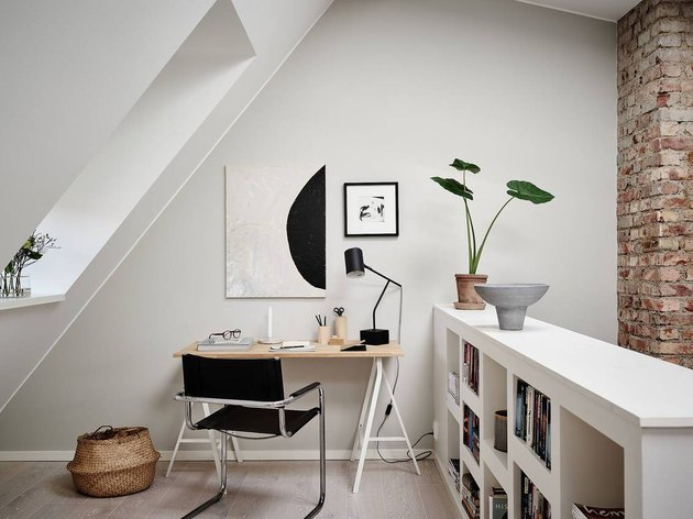 small attic library in home office with bookcase