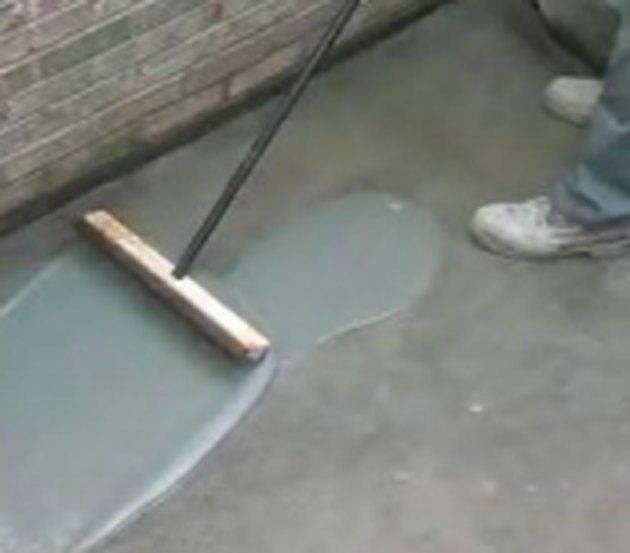 Resurfacing a concrete pad.