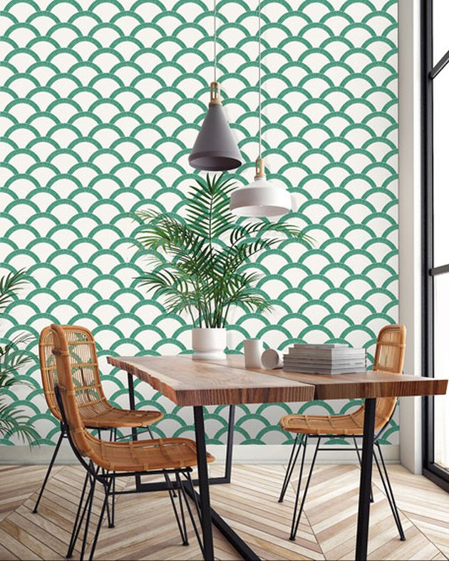 boho coastal dining room with green scallop coastal wallpaper