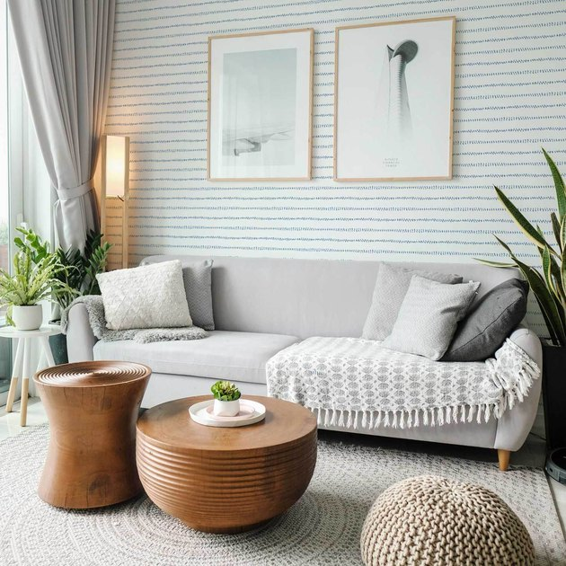 cosy coastal living room with watercolor blue stripes coastal wallpaper