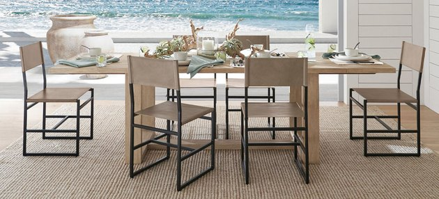 coastal furniture in a dining room overlooking the ocean