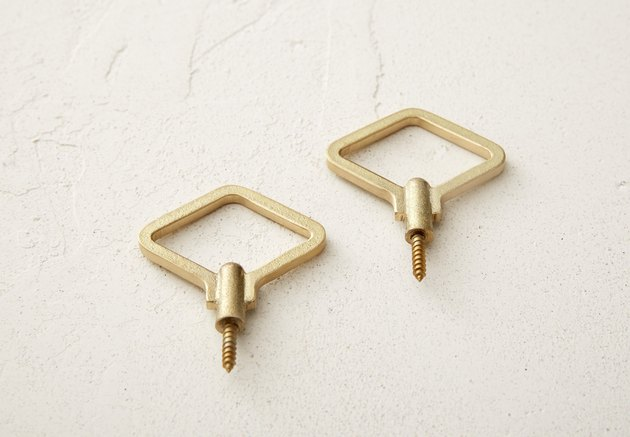 geometric wall hooks with brass finish
