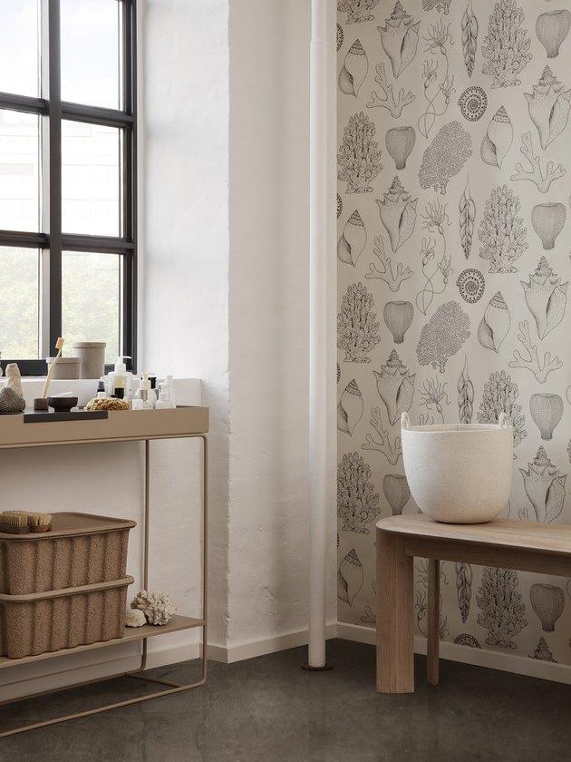 modern coastal bathroom with shell coastal wallpaper
