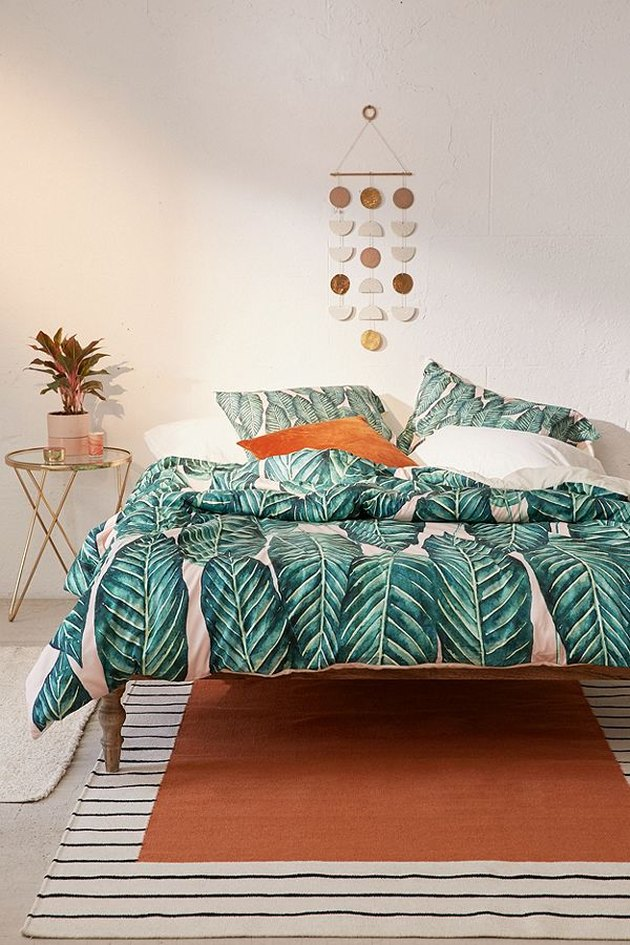 tropical bedroom with palm print duvet and pillowcases
