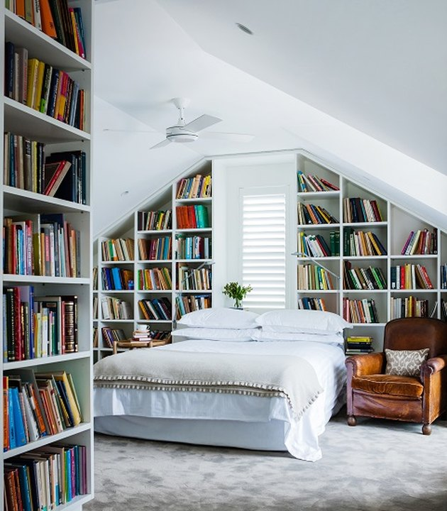 Attic Bedroom Furniture with bookshelves and ceiling fan by Mr. Waller