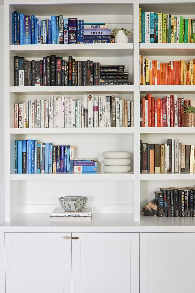 Built-in bookshelf with color-coded books