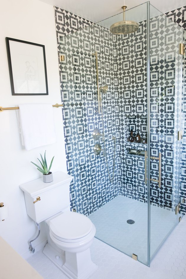 bathroom remodel with patterned wall tile in walk-in shower