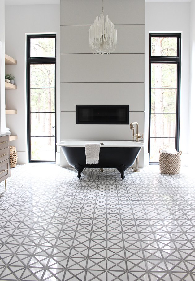 Modern bathroom with clawfoot bathtubs and patterned floor tile