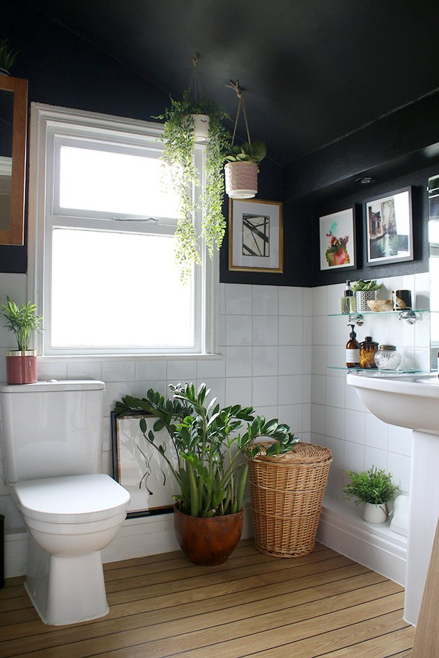 bohemian bathroom remodel with black walls and greenery