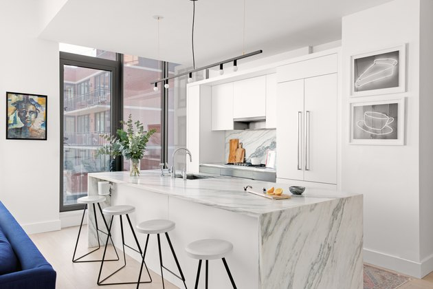 Kitchen with marble island and backsplash