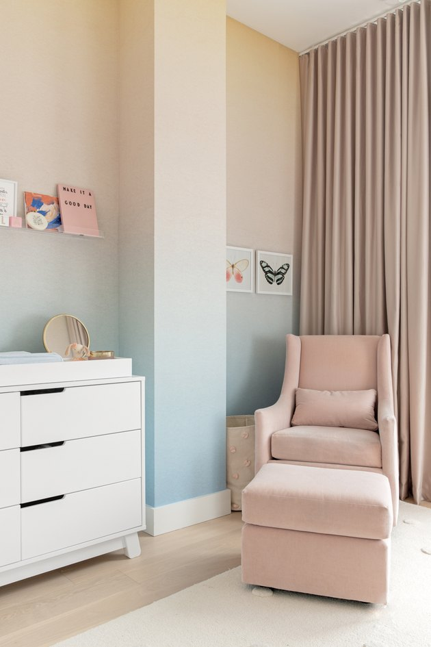 Nursery with pink and blue wallpaper